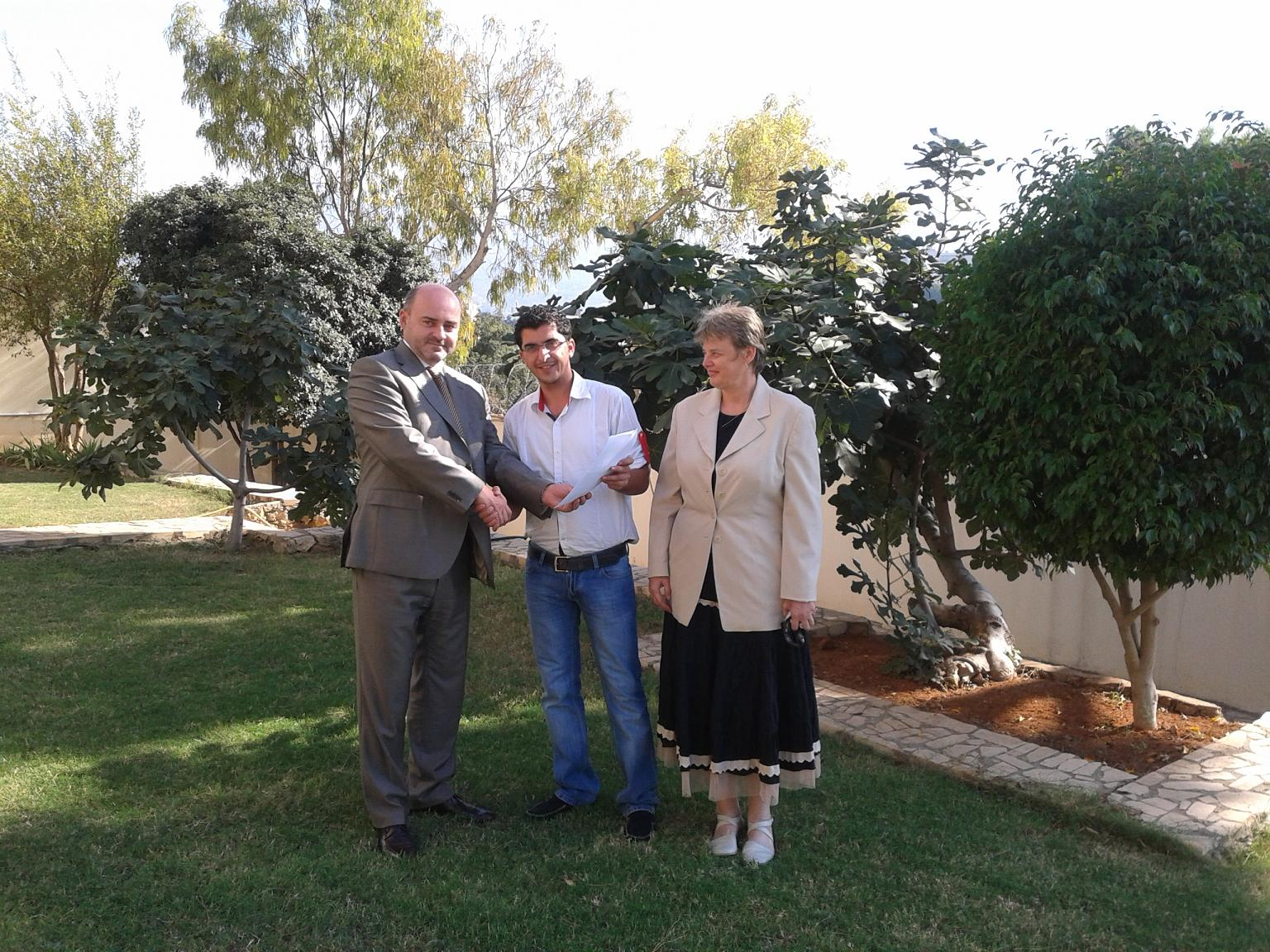 Ambassador Cumba and 1st Secretary Ivana Zuntova giving the Czech contribution to the Executive of Al Mishaal Sporting Club MVDr. Ali El Romeh (Beirut, 19.10.2012).