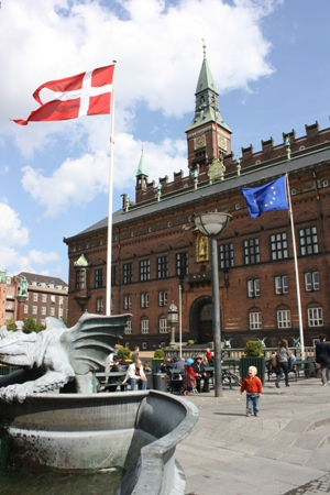 Danish and European flag flapping in front of the City Hall