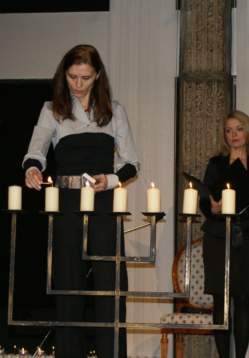 Mrs Zantovska lights a candle
